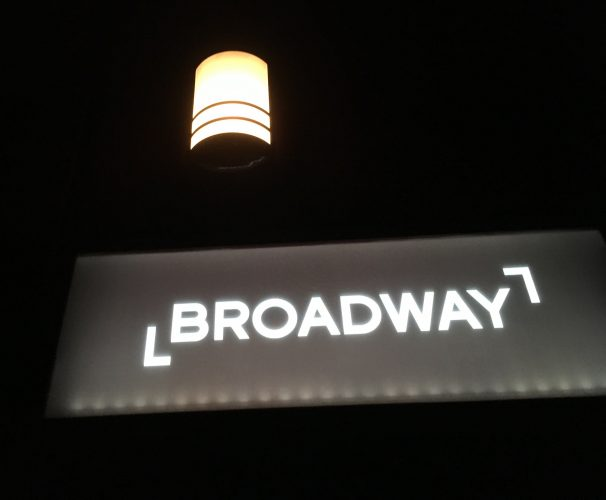 black background sign saying Broadway lit up in lights