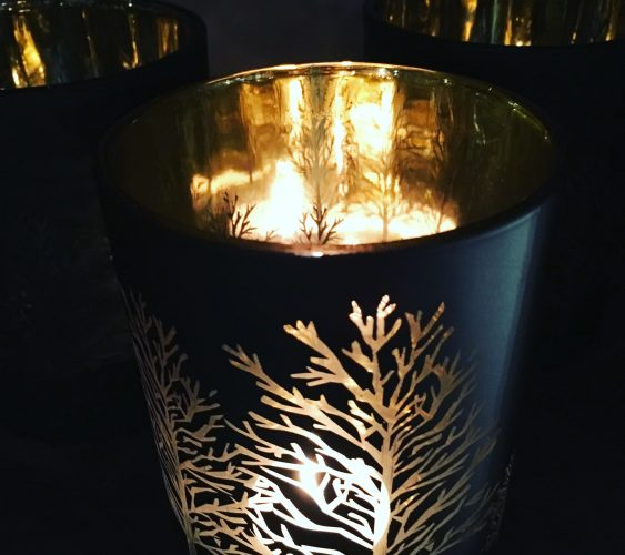 Warm candle glow with gold tealight holder and autumn winter tree matt black and gold